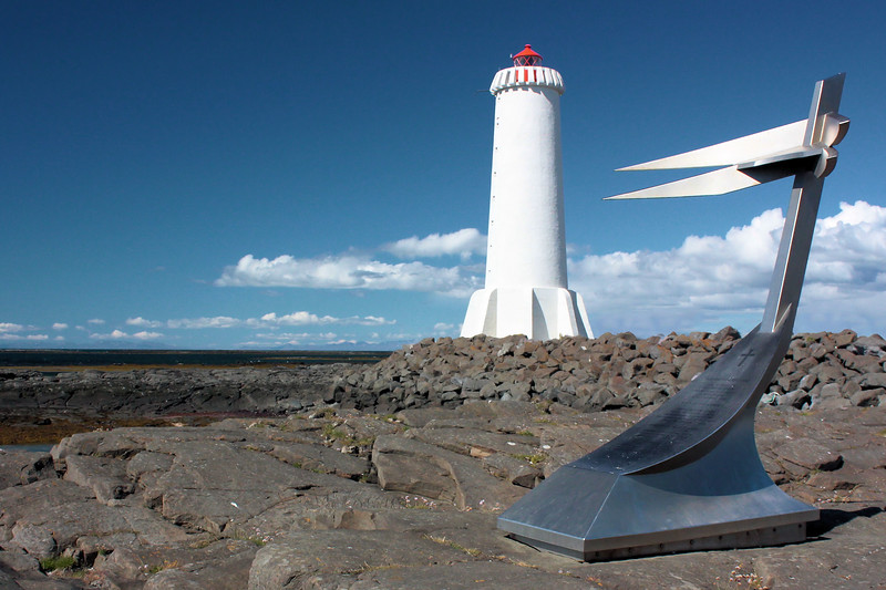 Alftanes lighthouse and memorial To a ship that sank offshore.  The ship was recovered and stands in a local museum.