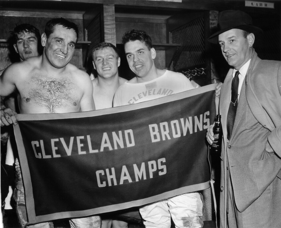 . The Cleveland Browns defeated the Pittsburgh Steelers on at a game in Cleveland, Ohio, Dec. 12, 1954, to win the NFL divisional championship. Coach Paul Brown, right, poses with some of the players in the dressing room after the game. From left to right they are Pete Brewster, Lou Groza, Chuck Noll, and Otto Graham. (AP Photo/Julian C. Wilson)