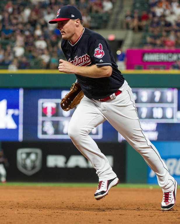 . Cleveland Indians\' Jay Bruce runs to cover first base and get Boston Red Sox\' Xander Bogaerts out during the eighth inning of a baseball game in Cleveland, Monday, Aug. 21, 2017. Cleveland won the game 5-4. (AP Photo/Phil Long)