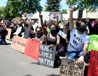 Hundreds gather outside City Hall to peacefully protest police brutality
