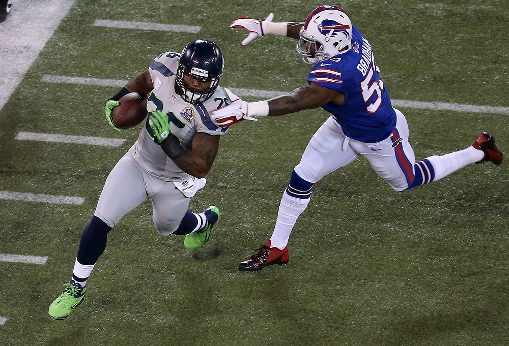 . Michael Robinson #26 of the Seattle Seahawks carries the ball during an NFL game as Nigel Bradham #53 of the Buffalo Bills closes in for a tackle at Rogers Centre on December 16, 2012 in Toronto, Ontario, Canada. (Photo by Tom Szczerbowski/Getty Images)