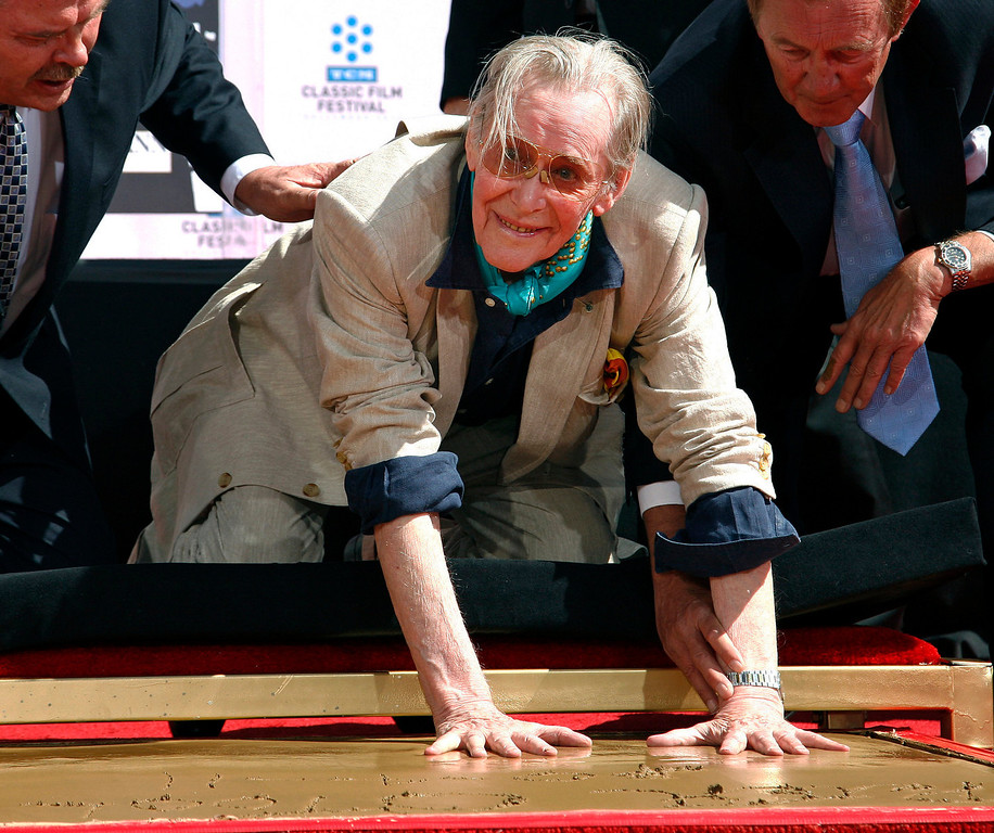 . Actor Peter O\'Toole places his handprints in cement as he is honored during the TCM Classic Film Festival at Grauman\'s Chinese Theatre in Los Angeles on April 11, 2011.  O\'Toole, the charismatic actor who achieved instant stardom as Lawrence of Arabia and was nominated eight times for an Academy Award, has died. He was 81. O\'Toole\'s agent Steve Kenis says the actor died Saturday, Dec. 14, 2013 at a hospital following a long illness. (AP Photo/Jason Redmond)