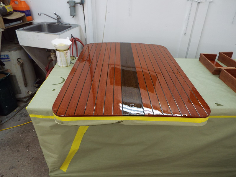 Engine hatch with varnish applied.