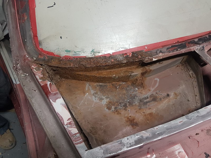 Top part of scuttle cut out, revealing that the structural panel beneath has started to rot out as well. This area is critical in a front end collision to prevent the engine ending up in your lap....