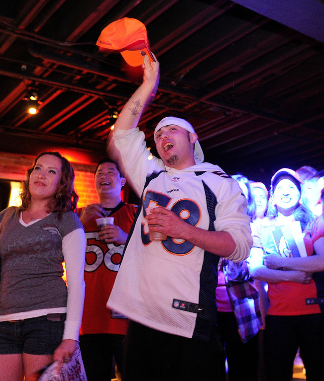. Mark DiGiacomo Jr. reacted as the Denver Broncos picked Sylvester Williams from North Carolina. Broncos fans gathered for a NFL draft party at the Tavern Downtown, 1949 Market Street, Thursday night, April 25, 2013. Photo By Karl Gehring/The Denver Post