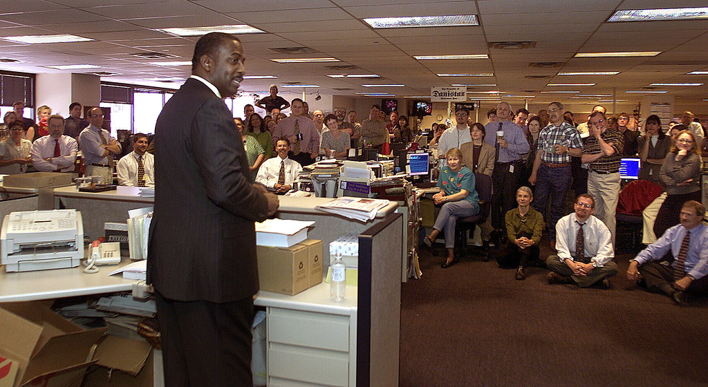 . New Denver Post Editor Greg Moore talks to the news staff during a meeting the Post newsroom after he was introduced by Publisher William Dean Singleton. (Jerry Cleveland, The Denver Post)