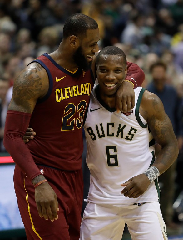 . Cleveland Cavaliers\' LeBron James talks to Milwaukee Bucks\' Eric Bledsoe after the second half of an NBA basketball game Tuesday, Dec. 19, 2017, in Milwaukee. The Bucks won 119-116. (AP Photo/Morry Gash)