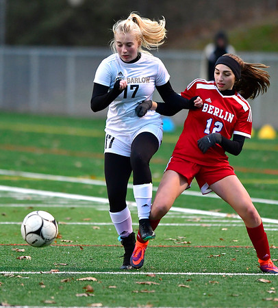 11/12/2019 MIke Orazzi | StaffrJoel Barlow High School's Ella Stalowir (17) and Berlin High School's Clare McGeever (12) during the Class L First Round Girls Soccer Tournament with Berlin in Sage Park in Berlin.