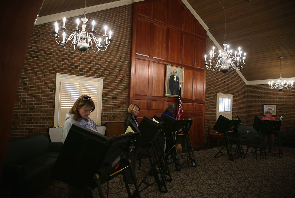 . Voters cast their ballots at a polling place at the Jamestown Town Hall November 4, 2014 in Jamestown, North Carolina. Today Americans will head to the polls to cast their vote in the mid-term elections. (Photo by Alex Wong/Getty Images)