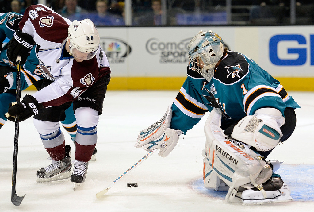 . SAN JOSE, CA - JANUARY 26: Thomas Greiss #1 of the San Jose Sharks stops the stops the shot of Mark Olver #40 of the Colorado Avalanche in the first period of their game at HP Pavilion on January 26, 2013 in San Jose, California. (Photo by Thearon W. Henderson/Getty Images)