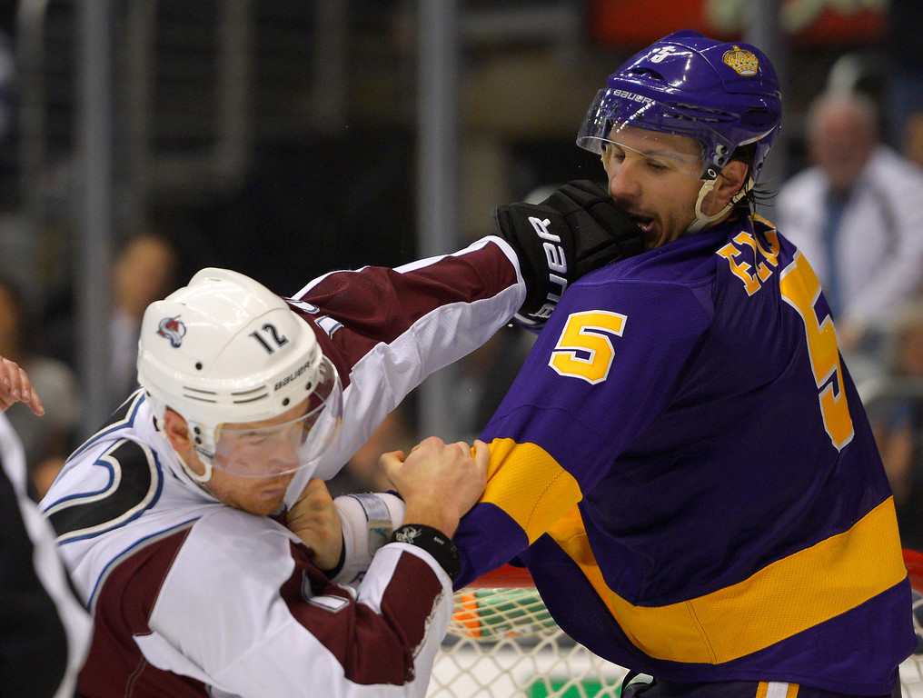 . Colorado Avalanche right wing Chuck Kobasew, left, fights Los Angeles Kings defenseman Keaton Ellerby during the third period of their NHL hockey game, Saturday, Feb. 23, 2013, in Los Angeles. The Kings won 4-1.  (AP Photo/Mark J. Terrill)