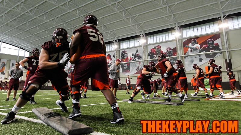 The offensive line unit goes through drills. (Mark Umansky/TheKeyPlay.com)