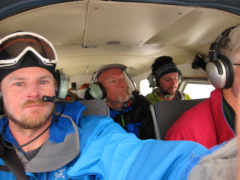 We were packed in small airplane. From left: Tim, Me, and John W (John DM was behind Tim)