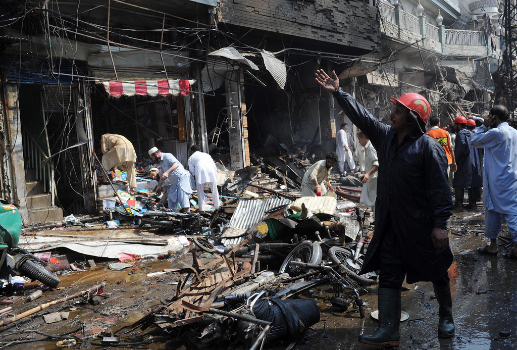 . Pakistani volunteers search the site of a bomb explosion in the busy Kissa Khwani market in Peshawar on September 29, 2013.  AFP PHOTO /  A. MAJEED/AFP/Getty Images