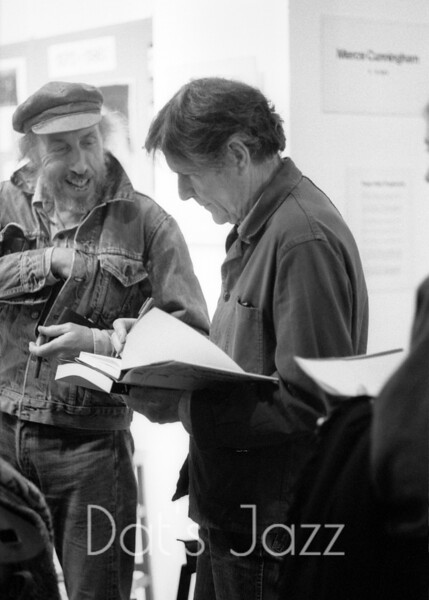 JOHN CAGE SIGNING AUTOGRAPH