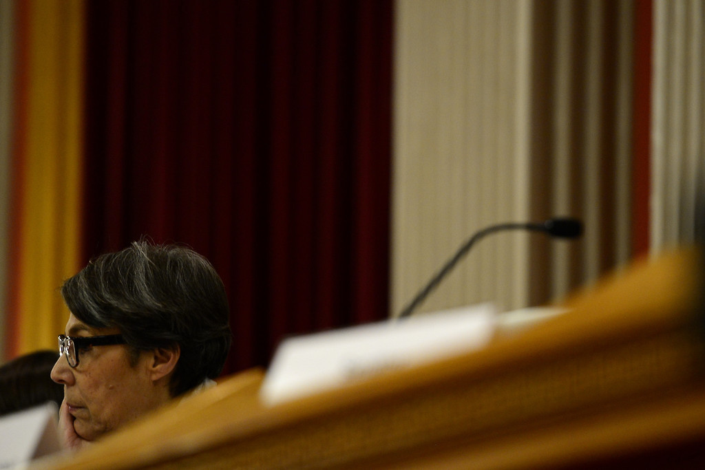 . DENVER, CO - MARCH 4: Senate Judiciary Committee Chair Lucia Guzman listens as Sen. John Morse testifies against assault weapons at the State Capitol. Four gun bills were up for debate. (Photo by AAron Ontiveroz/The Denver Post)