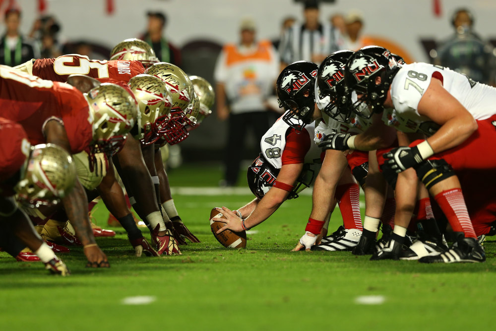 . Northern Illinois Huskies gets set to snap the ball against the Florida State Seminoles defense during the Discover Orange Bowl at Sun Life Stadium on January 1, 2013 in Miami Gardens, Florida.  (Photo by Mike Ehrmann/Getty Images)