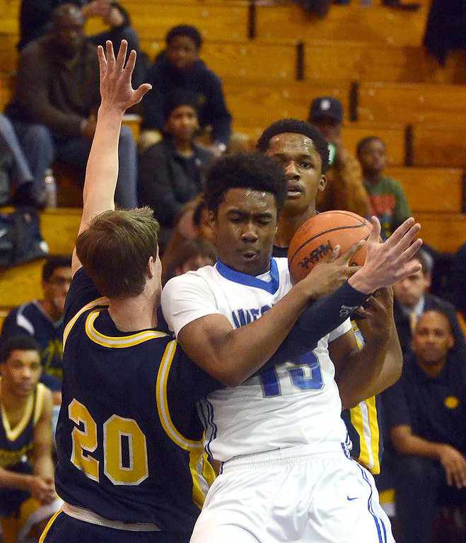 . Walled Lake Western\'s #15 John Flowers and Detroit Country Day\'s #20 Taylor Graffa tussle for the ball during their game at Walled Lake Western High School, Friday December 13, 2013. Western went on to win the game 73-69. (Vaughn Gurganian-The Oakland Press)