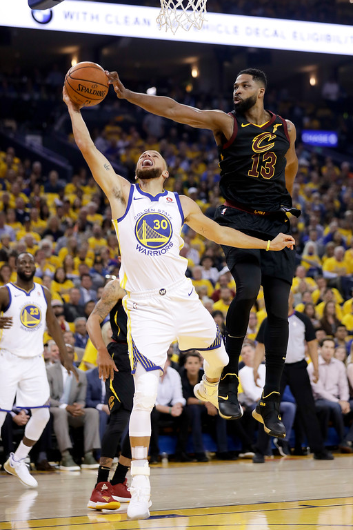 . Cleveland Cavaliers center Tristan Thompson (13) blocks a shot by Golden State Warriors guard Stephen Curry (30) during the first half of Game 1 of basketball\'s NBA Finals in Oakland, Calif., Thursday, May 31, 2018. (AP Photo/Marcio Jose Sanchez)