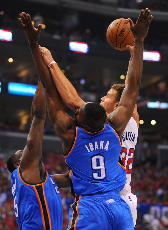 . The Clippers\' Blake Griffin goes to the basket against the Thunders\' Serge Ibaka, (#9) and Kendrick Perkins in game six of the Western Conference semifinals, Thursday, May 15, 2014, at Staples Center. (Photo by Michael Owen Baker/Los Angeles Daily News)