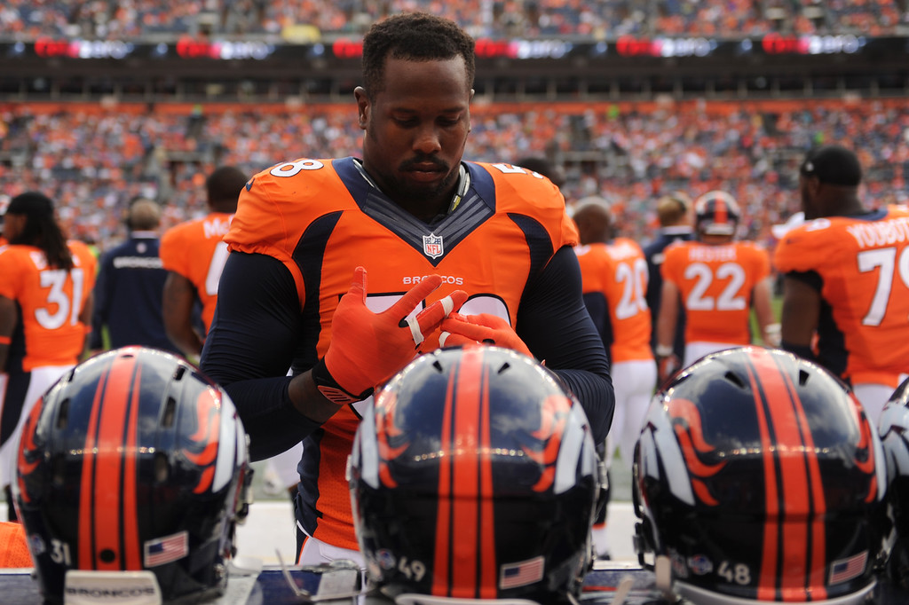 . DENVER, CO. - August 24: Outside linebacker Von Miller (58) of the Denver Broncos checking his tape before their game vs the St. Louis Rams during the 3rd pre-season game of the season at Sports Authority Field at Mile High. August 24, 2013 Denver, Colorado. (Photo By Joe Amon/The Denver Post)