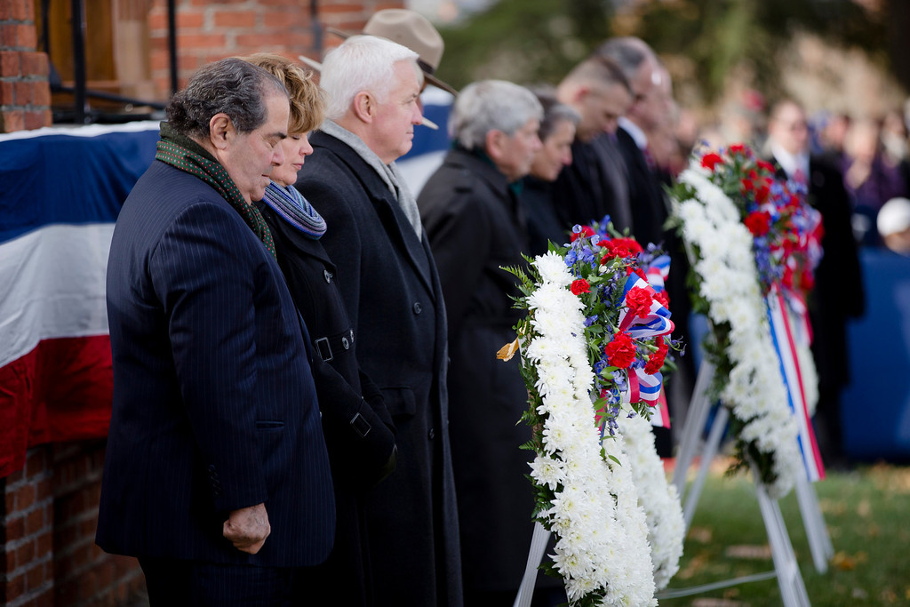 . Supreme Court Justice Antonin Scalia, left, Susan Corbett and her husband Pennsylvania Gov. Tom Corbett bow their heads for a moment of silence during a ceremony commemorating the 150th anniversary of the dedication of the Soldiers\' National Cemetery and President Abraham Lincoln\'s Gettysburg Address, Tuesday, Nov. 19, 2013, in Gettysburg, Pa. (AP Photo/Matt Rourke)