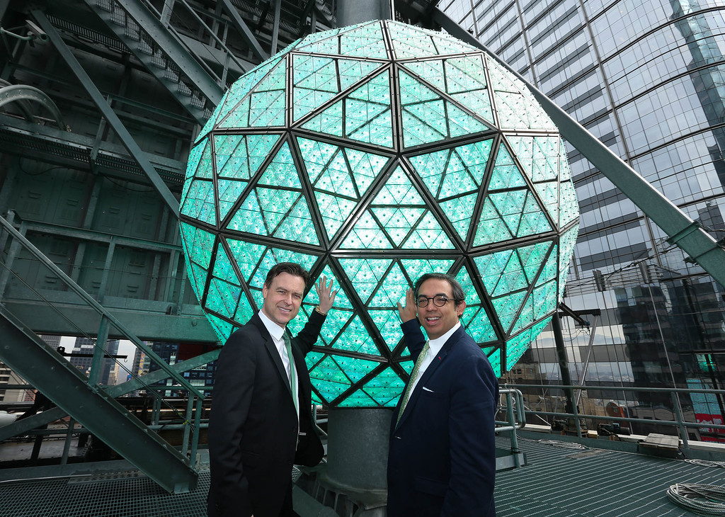 . Tom Brennan (L), Master Artisan at Waterford and Regan Iglesia, SVP Global Brand Director at Waterford poses with the Waterford Times Square New Year\'s Eve Ball turns green to celebrate St. Patrick\'s Day on March 17, 2015 in New York City.  (Photo by Rob Kim/Getty Images  for Waterford)