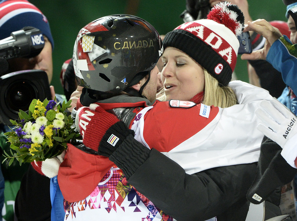 . Gold Medal winner, Canada\'s Alex Bilodeau kisses girlfriend Sabrina Bizier at the Men\'s Freestyle Skiing Moguls finals at the Rosa Khutor Extreme Park during the Sochi Winter Olympics on February 10, 2014.    FRANCK FIFE/AFP/Getty Images