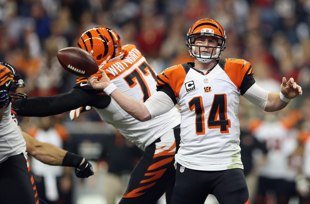 Description of . Andy Dalton #14 of the Cincinnati Bengals has the ball taken out of his hand on a forward pass against the Houston Texans during the AFC Wild Card Playoff Game at Reliant Stadium on January 5, 2013 in Houston, Texas.  (Photo by Ronald Martinez/Getty Images)