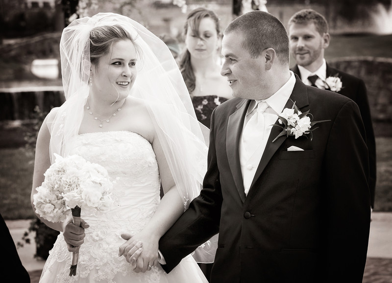 B+W Bride and Groom Coming down the aisle.jpg