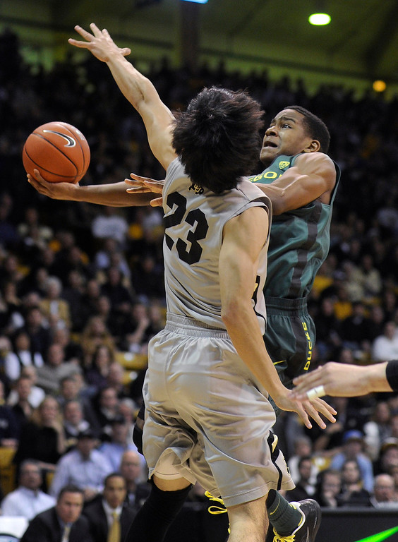 . BOULDER, CO. - MARCH 7: Oregon guard Dominic Artis (1) tried to drive past Colorado defender Sabatino Chen (23) in the first half. The University of Colorado men\'s basketball team hosted Oregon Thursday night, March 7, 2013 at the CU Events Center in Boulder. (Photo By Karl Gehring/The Denver Post)