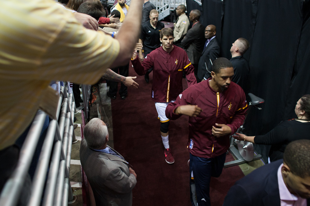 . Kyle Korver (left) and Channing Frye (right) of the Cleveland Cavaliers walk into the locker room during game 4 of the NBA Finals against the Golden State Warriors at the Quicken Loans Arena on June 10, 2017.  The Cavs defeated the Warriors 137-116.