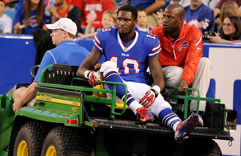 . Buffalo Bills\' Kevin Elliott (18) is carted off the field during the first half of an NFL preseason football game against the Minnesota Vikings Friday, Aug. 16, 2013, in Orchard Park, N.Y.  (AP Photo/Gary Wiepert)