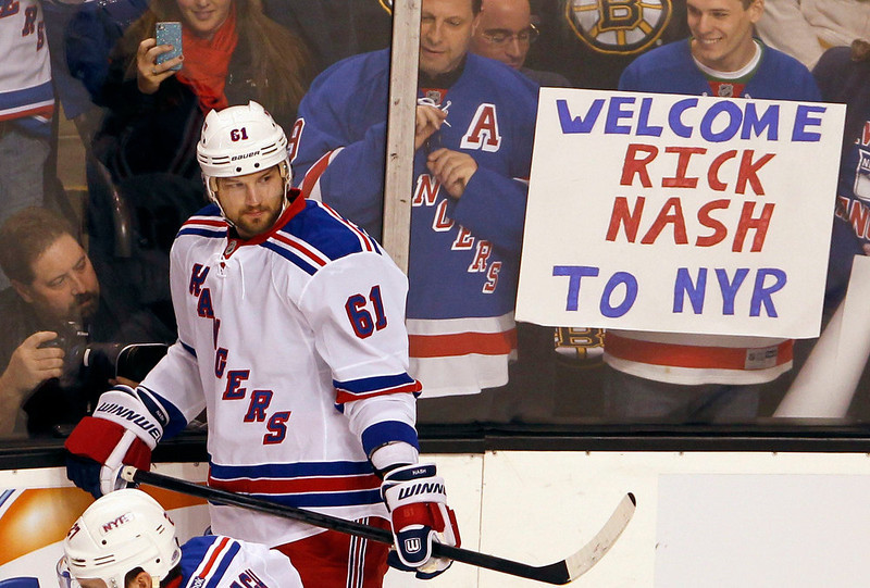 """. New York Rangers\' Rick Nash warms up in front of Rangers fans holding a sign that reads, \""""Welcome Rick Nash To NYR\"""" before the start of their NHL hockey game against the Boston Bruins at TD Garden in Boston, Massachusetts January 19, 2013. REUTERS/Jessica Rinaldi"""