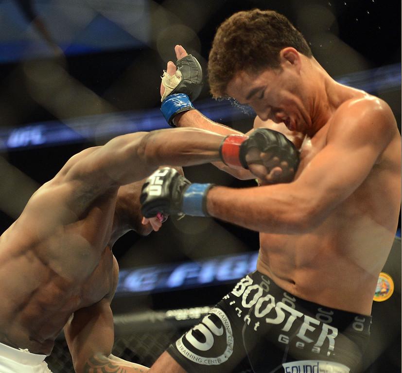 . Nah-Shon Burrell lands a hard right on Yuri Villefort during their UFC 157 match at the Honda Center in Anaheim Saturday, February  23, 2013.  (Hans Gutknecht/Staff Photographer)