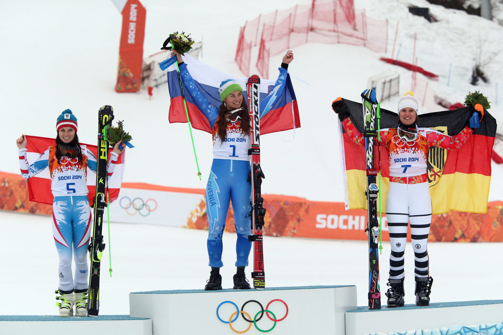 . Anna Fenninger of Austria (silver), Tina Maze of Slovenia (gold) and Viktoria Rebensburg of Germany (bronze) during the flower ceremony for the Women\'s Giant Slalom at the Rosa Khutor Alpine Center at the Sochi 2014 Olympic Games, Krasnaya Polyana, Russia, 18 February 2014.  EPA/ANTONIO BAT
