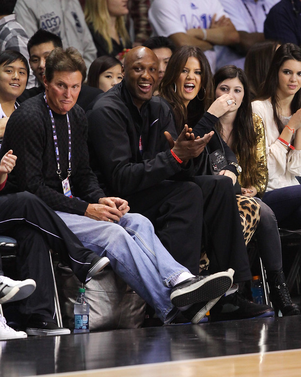 . (L-R) Bruce Jenner, Lamar Odom and Khloe Kardashian play at the 2011 BBVA NBA All-Star Celebrity Game at the Los Angeles Convention Center on February 18, 2011 in Los Angeles, California.  (Photo by Noel Vasquez/Getty Images)