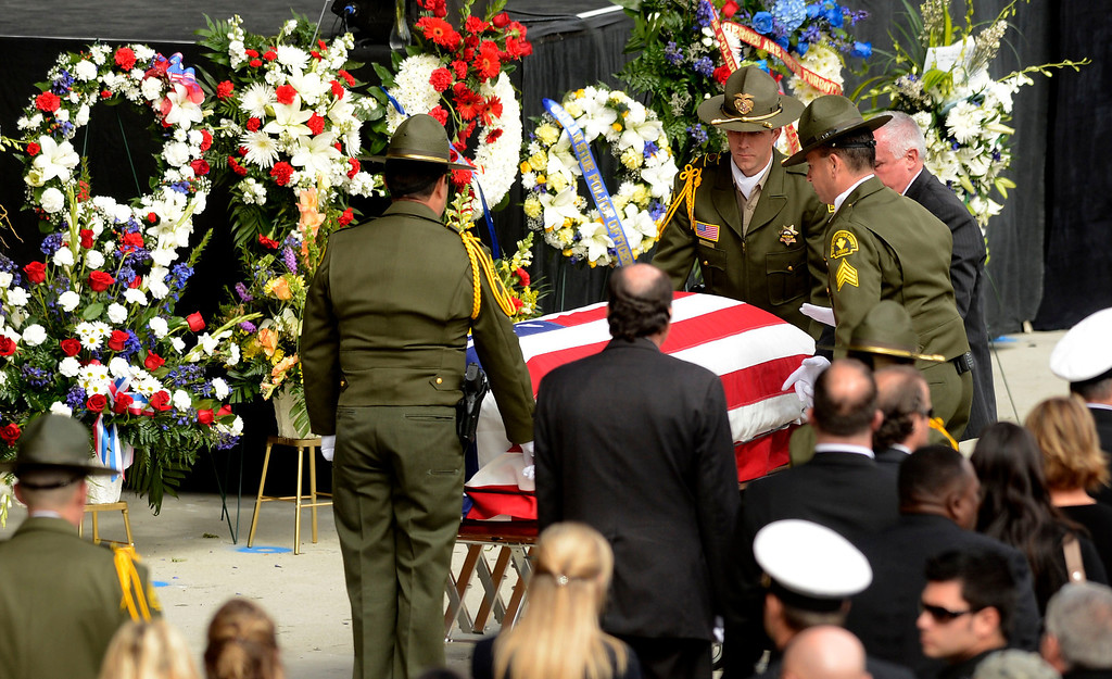 . San Bernardino County Sheriff Deputies tend to the casket of SBCO Sheriff Deputy Jeremiah MacKay during memorial services at the San Manuel Amphitheater in Devore February 21, 2013.  GABRIEL LUIS ACOSTA/STAFF PHOTOGRAPHER.