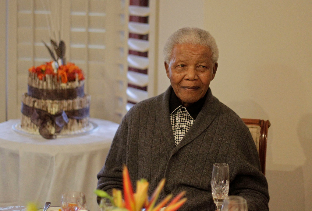 . Former South African President Nelson Mandela as he celebrates his birthday with family in Qunu, South Africa, Wednesday, July 18, 2012. Across the country, and even abroad, people did good deeds to honor the country\'s most famous statesman on his 94th birthday Wednesday.(AP Photo/Schalk van Zuydam)