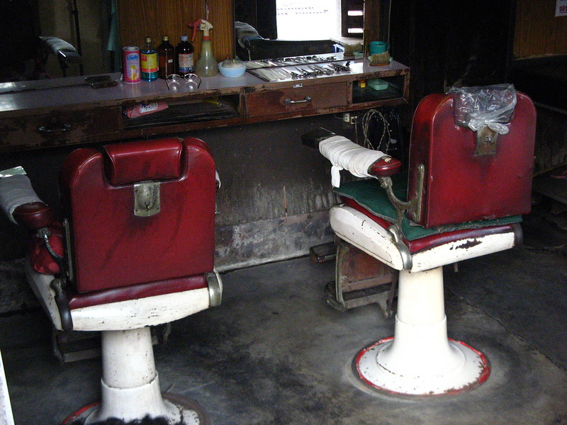 Barber shop on Sarasin under the wooden windows.