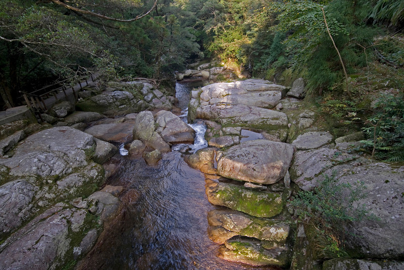Beautiful streaks of sunlight in rocks at the creek of Shiratani Unsuikyo