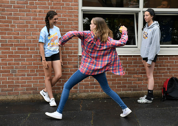 6/1/2018 Mike Orazzi | Staff Bristol Eastern High School junior Paige McLaughlin attempts to dunk principal Marisa Calvi-Rogers during the SAT fair for juniors on Friday in the school's courtyard.