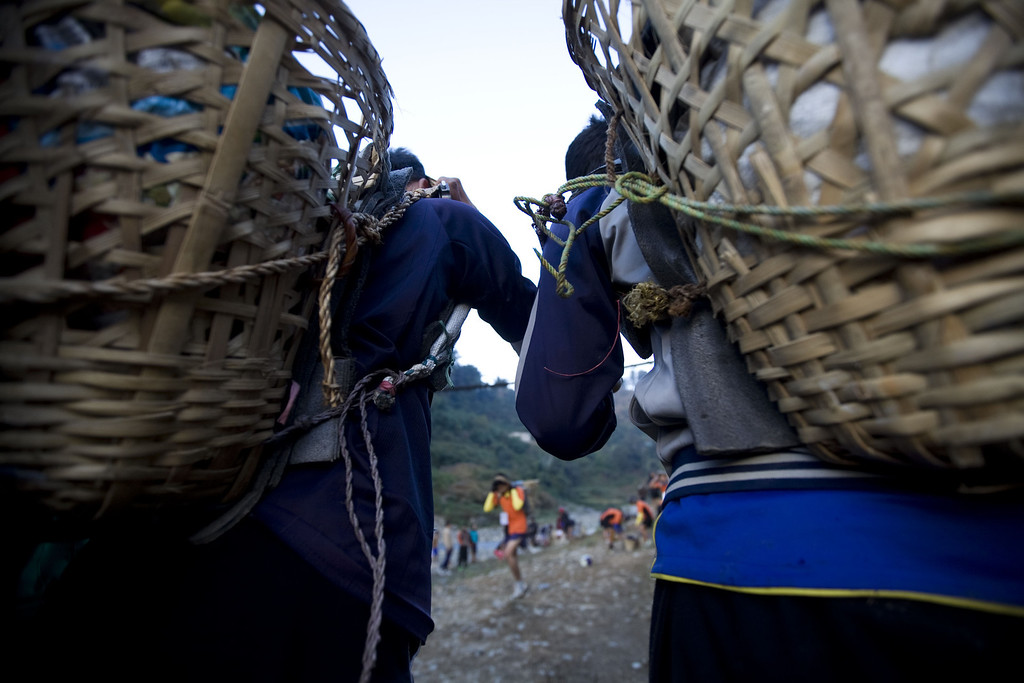 . Nepalese youths carry baskets locally known as \'Doko\' containing 25 kg of stones as part of a physical training session, organized by a private institute in Phokhara who prepares them for the British Gurkha soldier recruitment selection, at Malam Mountain in Kaski district, Nepal, 18 November 2012. The British Gurkha soldier recruitment selection process started on 23 November and runs untill the end of December 2012 at British Gurkha camp situated in Pokhara City, Nepal.Around 125 youths will be selected from more than three thousands participants. Those selected will join the British Army, a selection which carries much prestige and admiration throughout Nepalese society.  EPA/NARENDRA SHRESTHA