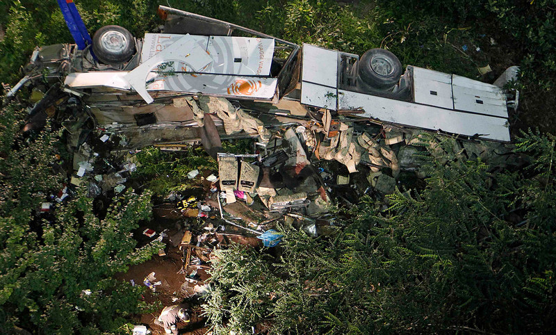 . A damaged coach is seen after a crash near the southern town of Avellino July 29, 2013. At least 36 people died after the bus plunged more than 15 metres (49 feet) off a viaduct in southern Italy on Sunday, a spokesman for the fire service said. REUTERS/Ciro De Luca