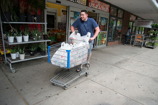 06/07/19 Wesley Bunnell | Staff Cody Fuentes exits the C-Town Grocery Store in New Britain on Friday afternoon. Fuentes normally uses reusable bags but didn't have them on him for todays shopping.