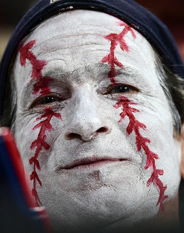 . A Cleveland Indians fan watches in the seventh inning of Game 1 of a baseball American League Division Series between the New York Yankees and the Indians, Thursday, Oct. 5, 2017, in Cleveland. (AP Photo/David Dermer)