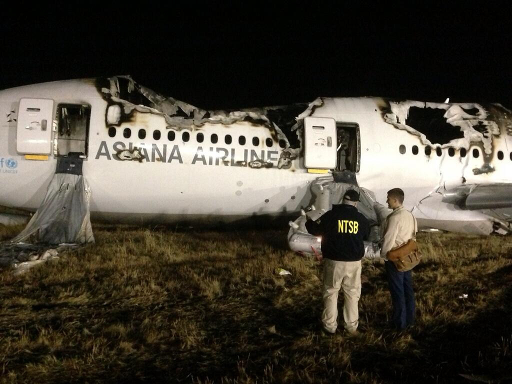 . In this photo provided by the National Transportation Security Board, investigators conduct a first site assessment overnight of the Asiana Airlines flight 214 that crashed at the San Francisco International Airport in San Francisco, Saturday, July 6, 2013. The Asiana Airlines Boeing 777 crashed while landing after a likely 10-hour-plus flight from Seoul, South Korea. The flight originated in Shanghai and stopped in Seoul before the long trek to San Francisco. (AP Photo/NTSB)