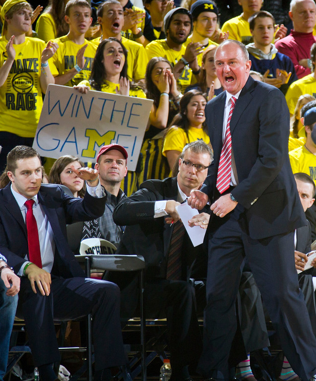 . Ohio State head coach Thad Matta, right, reacts courtside in the first half of an NCAA college basketball game against Michigan in Ann Arbor, Mich., Sunday, Feb. 22, 2015. (AP Photo/Tony Ding)