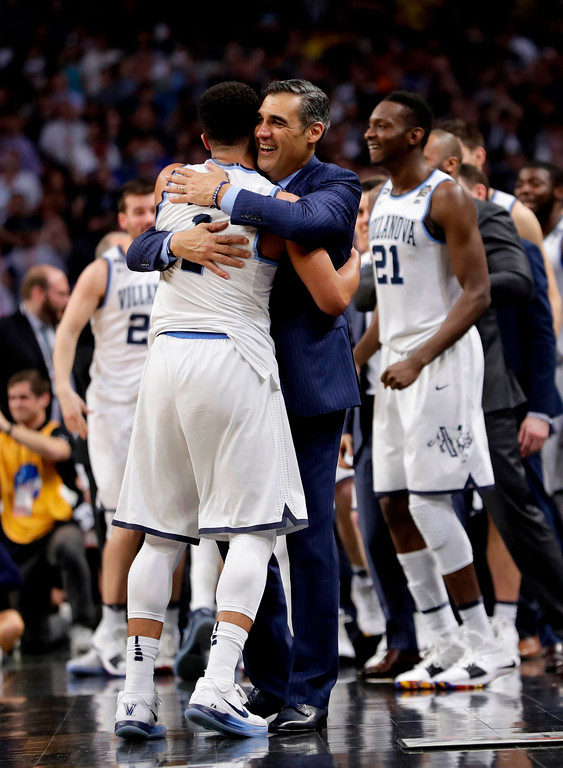 . Villanova head coach Jay Wright hugs guard Jalen Brunson (1) at the end of the championship game against Michigan in the Final Four NCAA college basketball tournament, Monday, April 2, 2018, in San Antonio. Villanova won 79-62. (AP Photo/Eric Gay)
