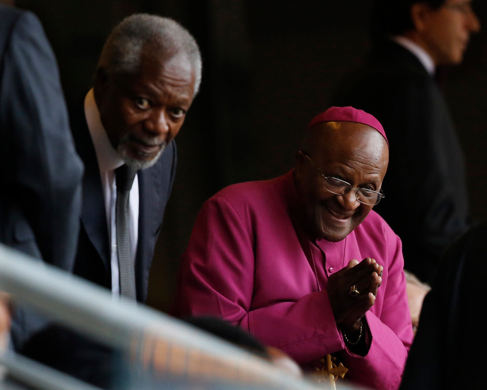. Retired Anglican Archbishop Desmond Tutu, right, arrives with Former U.N. Secretary-General Kofi Annan for the memorial service for former South African president Nelson Mandela at the FNB Stadium in Soweto near Johannesburg, Tuesday, Dec. 10, 2013. (AP Photo/Ben Curtis)
